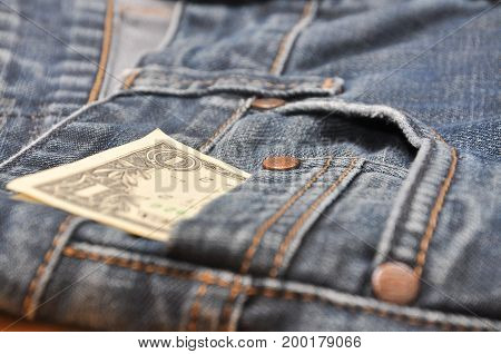 One dollar banknote in jeans pocket background. Money in your pocket