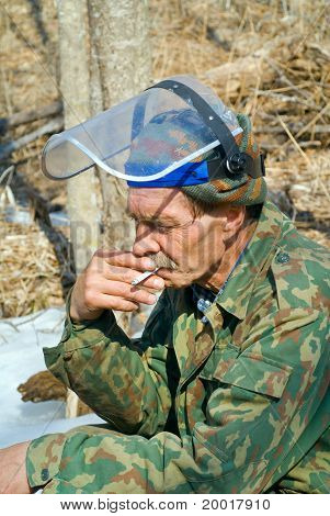Worker Smoking In Forest