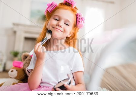 Child Applying Face Powder