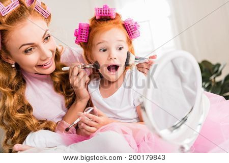 Mother And Daughter Doing Makeup