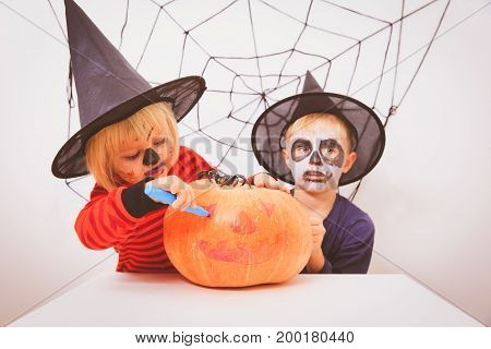 cute little girl and boy prepare for Halloween party