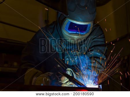 welder craftsman erecting technical steel Industrial steel welder in factory