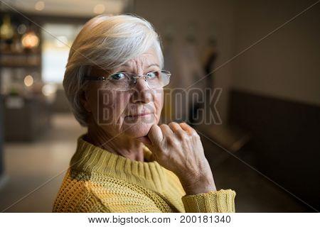 Close-up of smiling senior woman looking at camera
