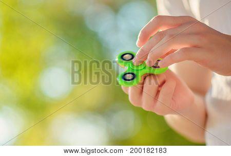 Teenager On The White T-shirt  Hand Holding Popular Antistress Fidget Spinner