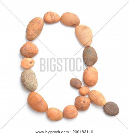 collection of letters of ocean stones close-up isolated on white background