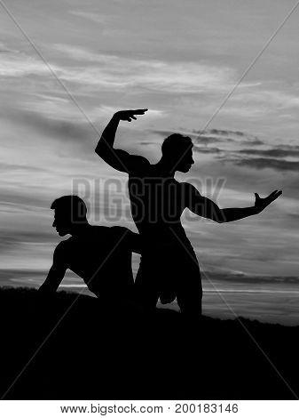 Silhouette Of Men In Sunset