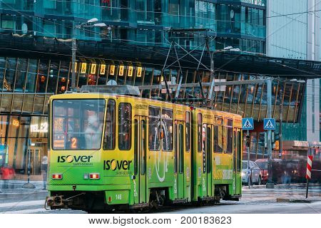 Tallinn, Estonia - December 3, 2016: Public Tram With Number Of Two Route On Background Of Shopping Center Foorum Keskus Located In The Center Of Tallinn On Narva Street.