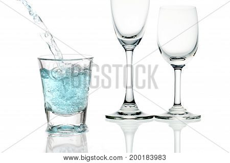 blue cocktail with splashes on white background