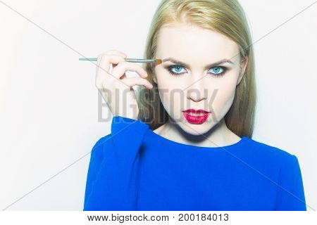 Makeup Of Fashionable Girl With Brush Neat Face