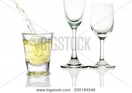 yellow cocktail with splashes on white background
