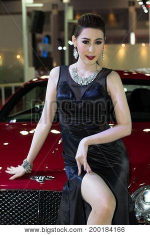 Bangkok Thailand - March 28 2014: Unidentified female presenter of Bentley car in Bangkok Motor Show 2014