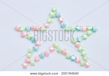colorful star paper arranging in star shape on white background