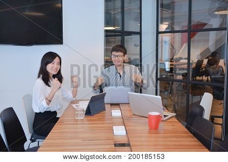 Group of Asian business people meeting in a meeting room