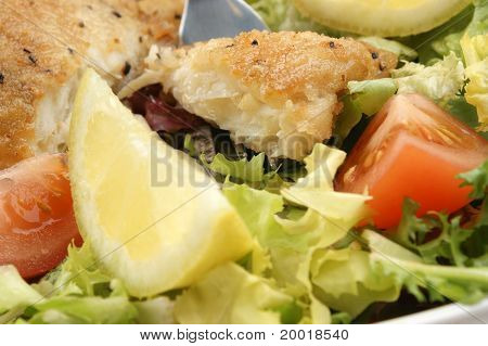A Piece Of Fried Sole Fillet With A Fork