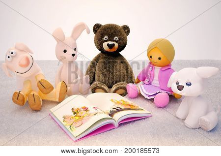 Baby toys and interesting book located on the carpet. Children education and development happy childhood. 3D illustration