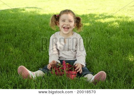 happy young girl sitting on grass