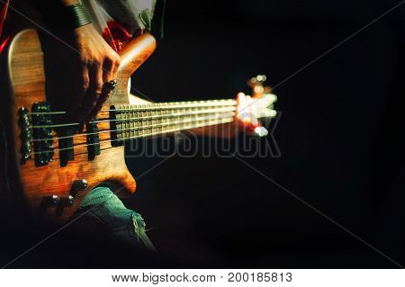 Bassist Pop Rock During A Performance At A Concert
