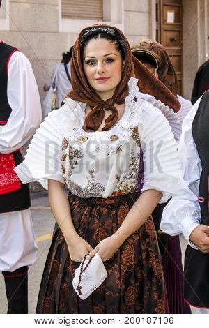 CAGLIARI, ITALY - MAY 1, 2016: 360 Feast of Sant'Efisio, portrait of a beautiful woman wearing a traditional Sardinian costume - Sardinia
