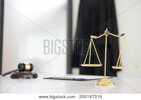 Scales of justice and gavel Judge hammer on brown wooden desk with copy space. Legislation Concept