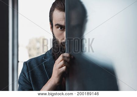 Bearded Man Hiding By Frosted Glass