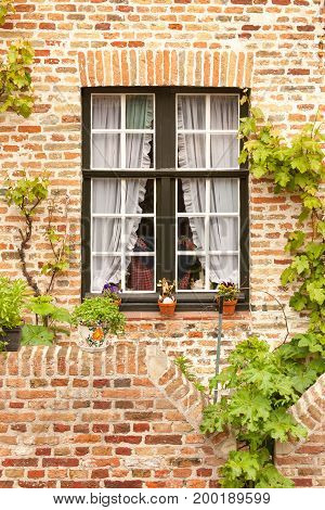 Traditional window of old brick house in Bruges, Belgium