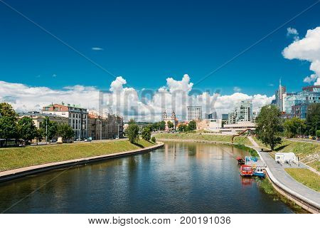 Vilnius, Lithuania. Cityscape With Church Of St Raphael The Archangel And Former Jesuit Monastery In Sunny Summer Day.