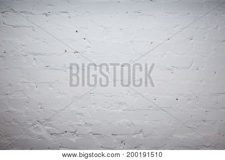 White brick wall for background or texture with vignetting