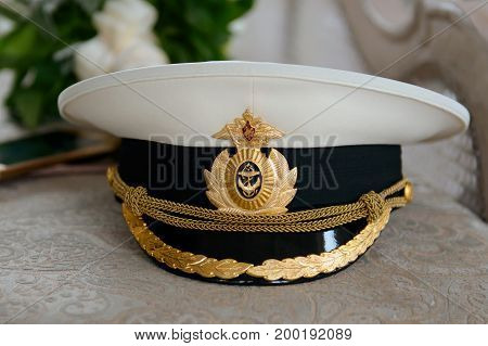 The officers parade cap white Navy of Russia. Headdress of a naval officer of the armed forces.