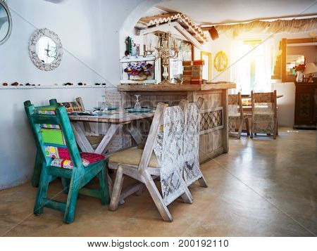 A small dining room in a rustic house, in an old style.