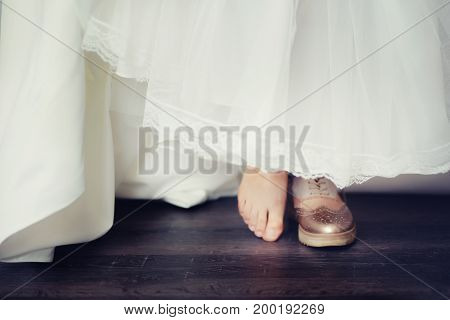 background blur bride in comfortable wedding shoes sneakers, the concept of choosing shoes shoes or sneakers or barefoot.