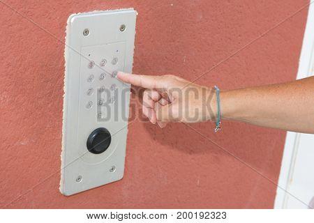 hand woman is opening door with intercom