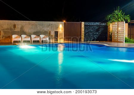 Swimming Pool At A Luxury Caribbean, Tropical Resort At Night, Dawn Time.