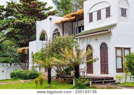 Modern And Luxurious Residence Holiday Villa House, Exterior Facade Of Building On Resort. Front Vie