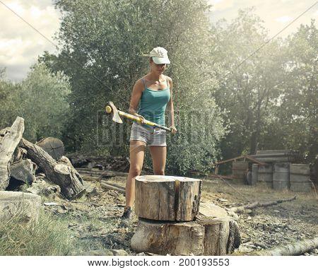 Girl chopping wood