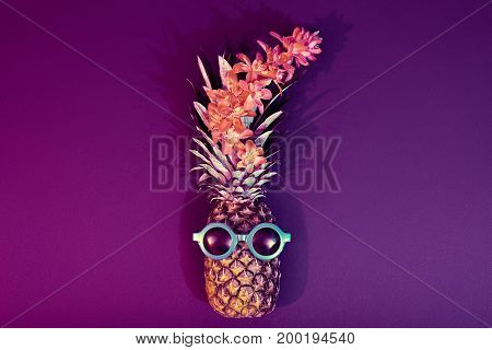 Tropical pineapple with Disco Sunglasses, flower. Pineapple Fruit Fashion Hipster. Beach Fun Art Style.Minimal.Night club.Hot Summer Glamour Beach Vibes.