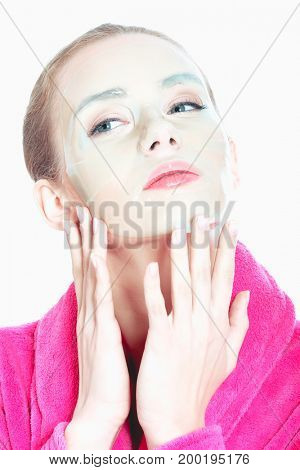 Beautiful young woman with facial mask. Spa concept.