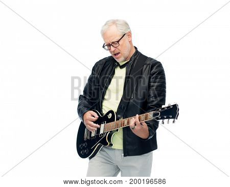 music, age and people concept - happy senior man playing electric guitar and singing