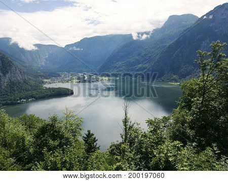 Mountain lake, Alpine massif, beautiful canyon in Austria. Alpine valley in summer clear water. Healthy virgin mountain nature, destination for vacation, bird perspective. Salzburg Hallstatt landscape