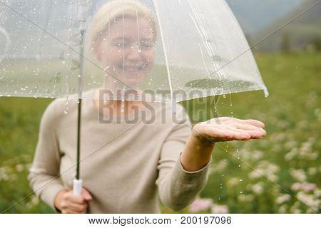 Portrait Of Smiling Woman Under Umbrella In Rain.