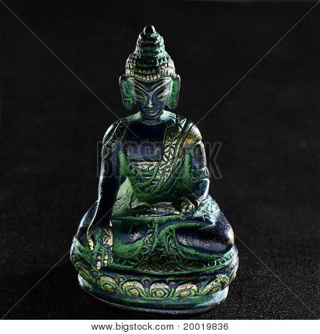 Bronze Buddha statue on black background