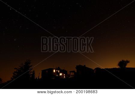 Night view of camping and shelter. Stars on the sky.