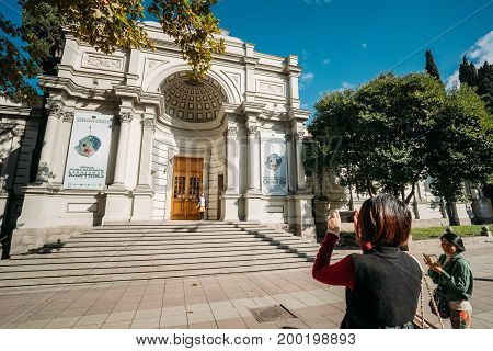Tbilisi, Georgia - October 29, 2016: Tourists From China Taking Photo Georgian National Gallery Built Based On Resolution From Russian Tsar In 1888. Now Gallery Is Part Of Georgian National Museum.