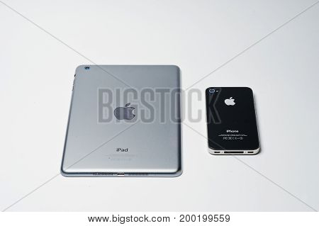 Hai, Ukraine - August 10, 2017: Ipad Tablet And Iphone 4 Smartphone Produced By Apple Laying On The