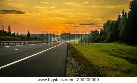 Dawn on a deserted road in Russia