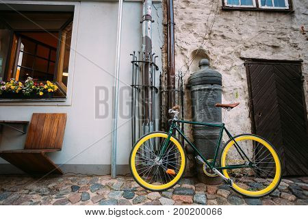 Single Bicycle Bike Parked Near Old Cannon On Street In Old Part European Town In Summer Evening.