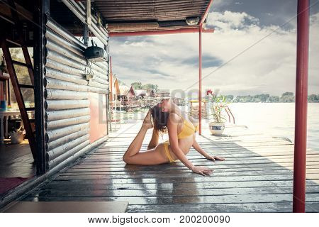 summertime yoga young woman practice yoga in bikini on wooden river raft