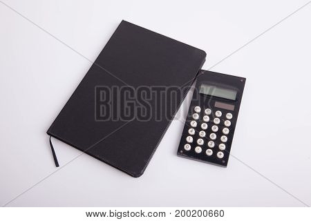Black Notebook And Calculator