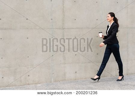 Hotel Manager Girl Holding Hot Espresso Coffee Cup