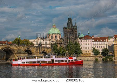 Charles bridge over the Vltana river with the old city Totwer of Prague