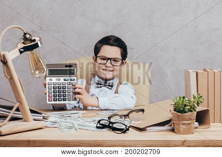 Smiling Kid With Calculator